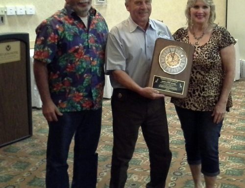 EOY Winners Rod & Mary Silva receive clock from ABS president David Hyatt